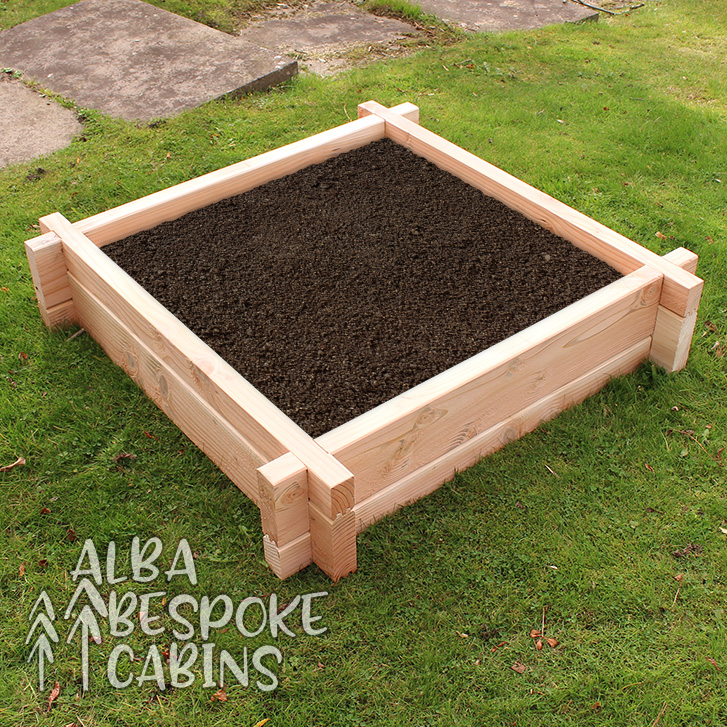 Square raised bed made from Douglas Fir. Douglas Fir lasts twice as long as other timbers. The bed is 1000mm to the outside of each edge, and the height is 225mm.